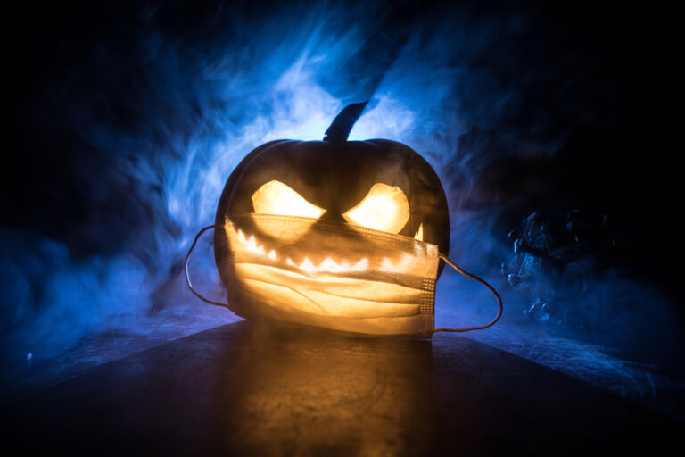 Halloween pumpkin with face mask.