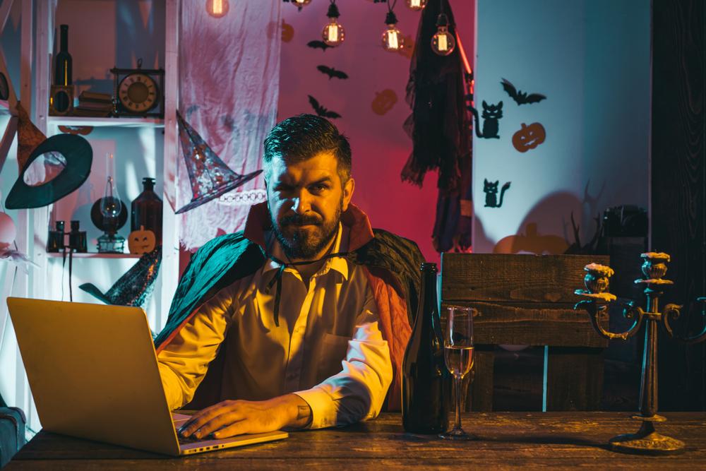 Man celebrating Halloween online.
