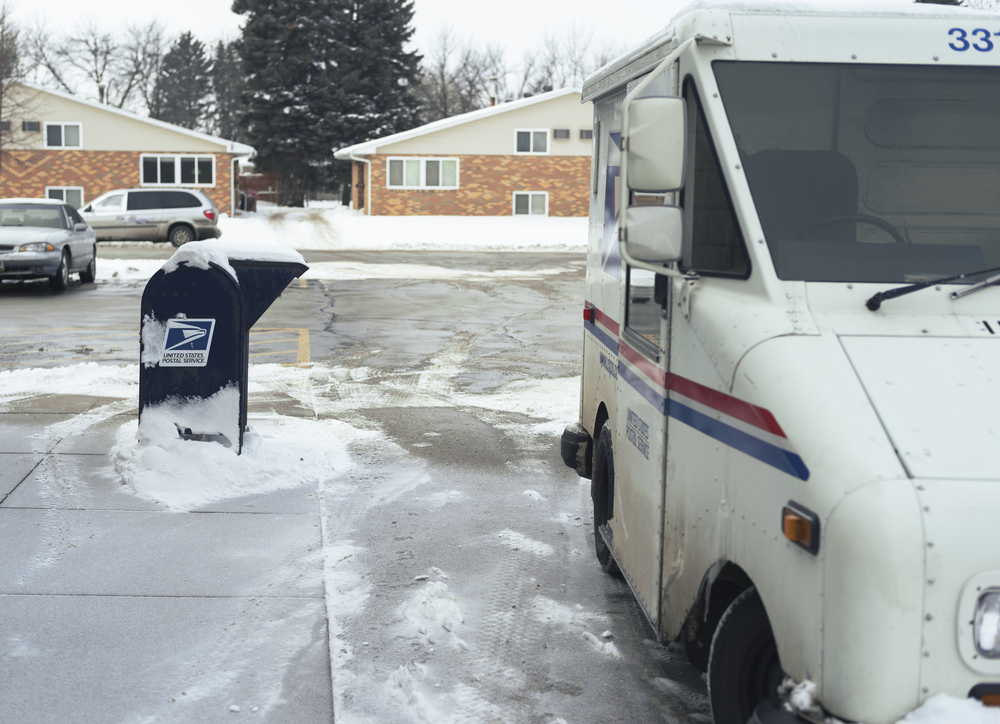 USPS truck on icy road.